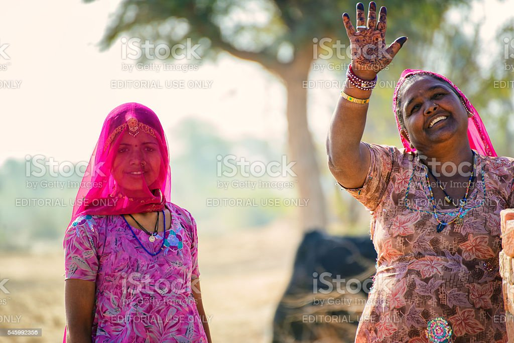 Mother and daughter waving goodbye stock photo