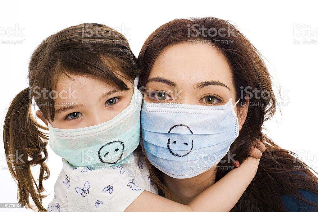Mother and daughter wearing surgeon's masks royalty-free stock photo