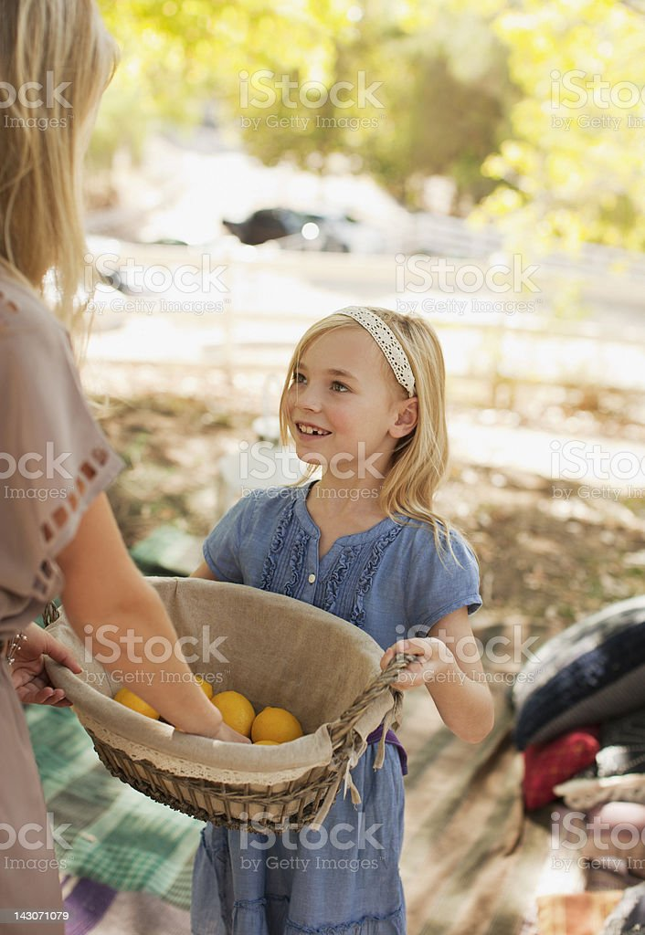 Mother and daughter with basket of lemons royalty-free stock photo