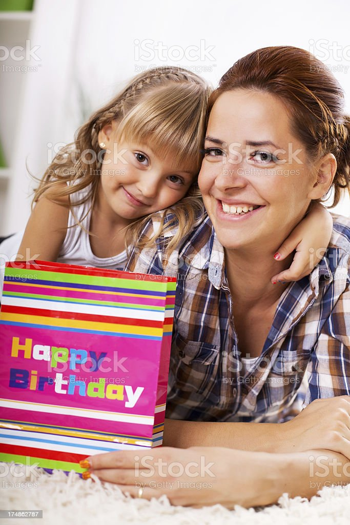 Mother and daughter with birthday present. royalty-free stock photo