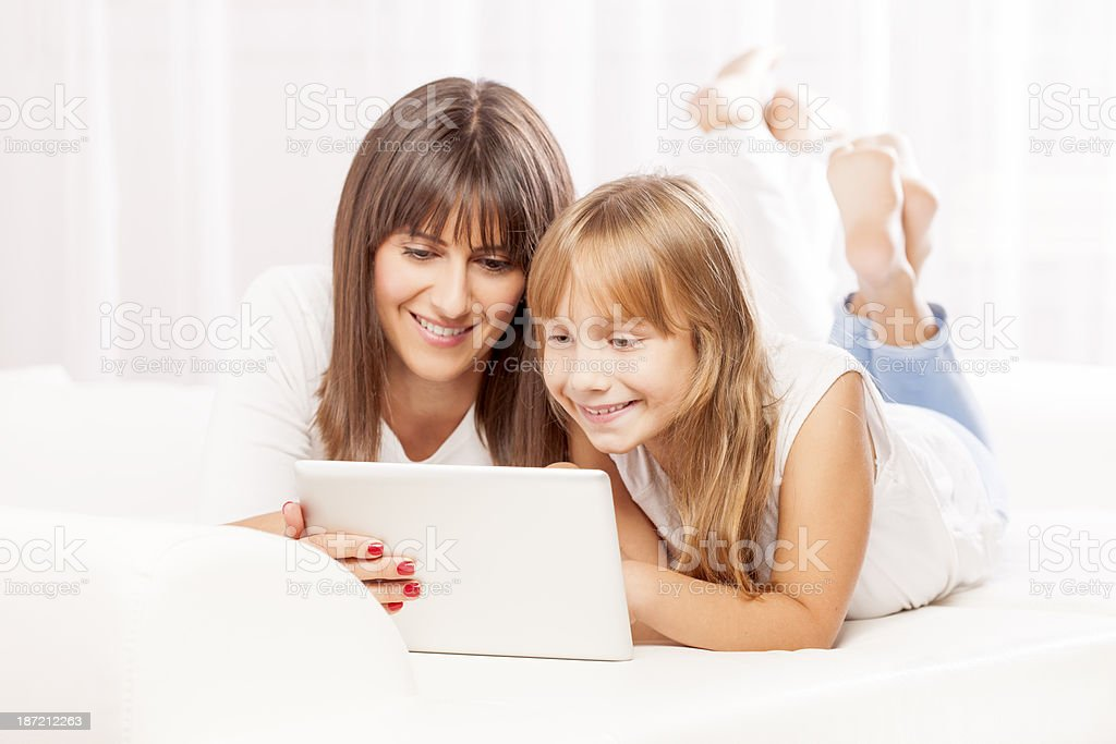 Mother and daughter with digital tablet royalty-free stock photo