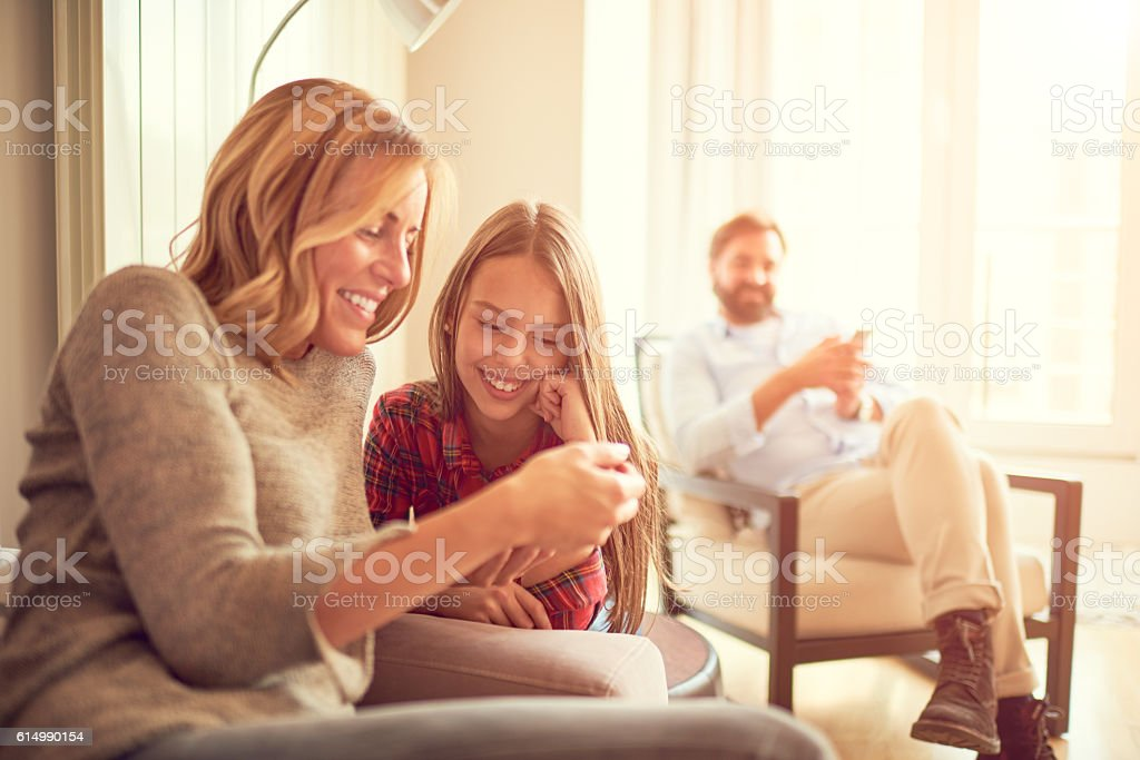 Mother and daughter with digital tablet stock photo