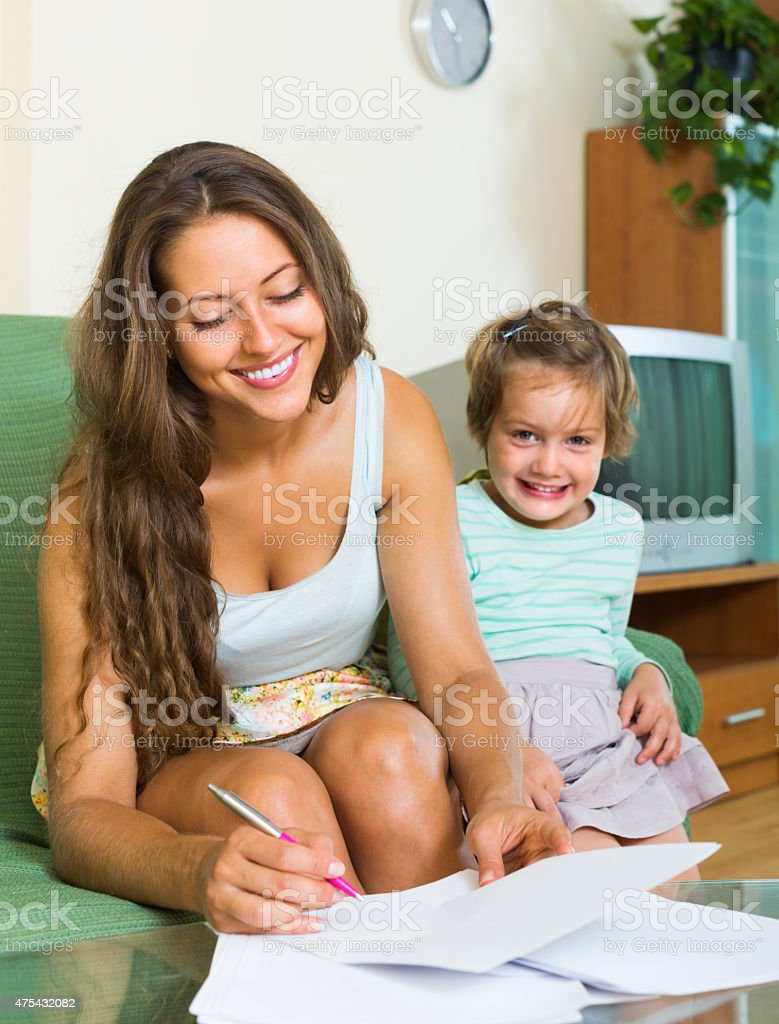 Mother and daughter with document stock photo