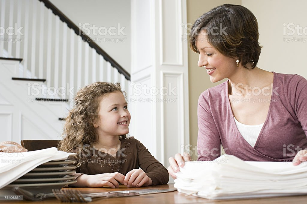 Mother and daughter with napkins royalty-free stock photo