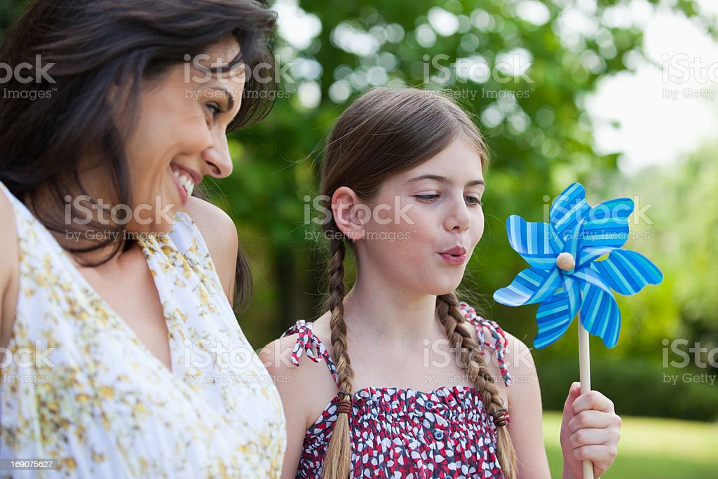 Mother and daughter with pinwheel royalty-free stock photo