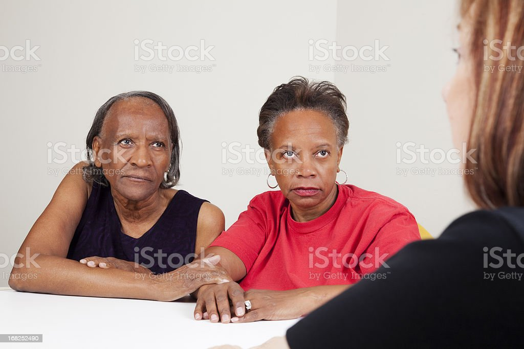 mother and daughter with social worker royalty-free stock photo