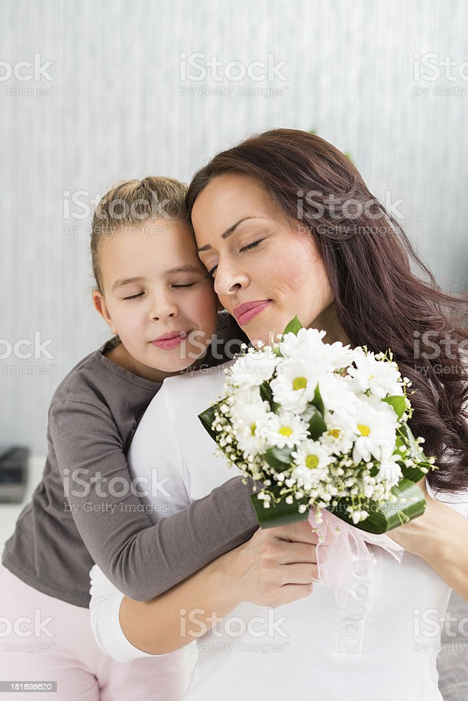 Mother and daughter with spring flowers royalty-free stock photo