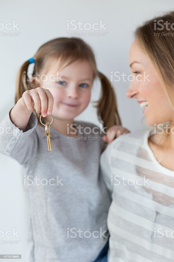 Mother and Daughter with the Keys to their New House stock photo