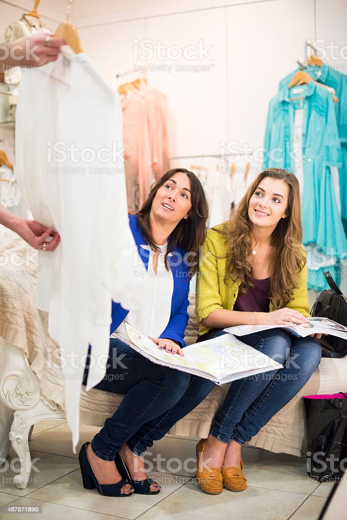 mother and daughter with their personal shopper stock photo