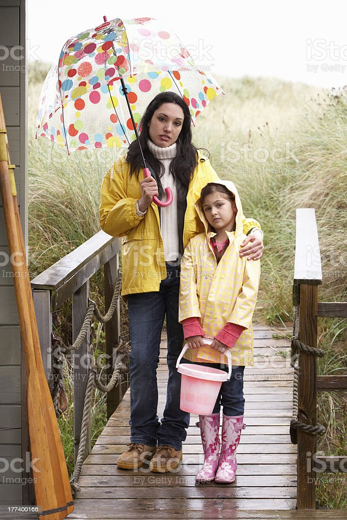 Mother and daughter with umbrella royalty-free stock photo