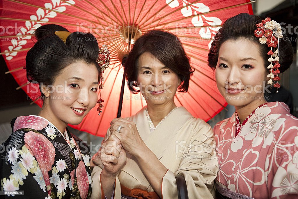 Mother and Daughters in Traditional Kimono stock photo