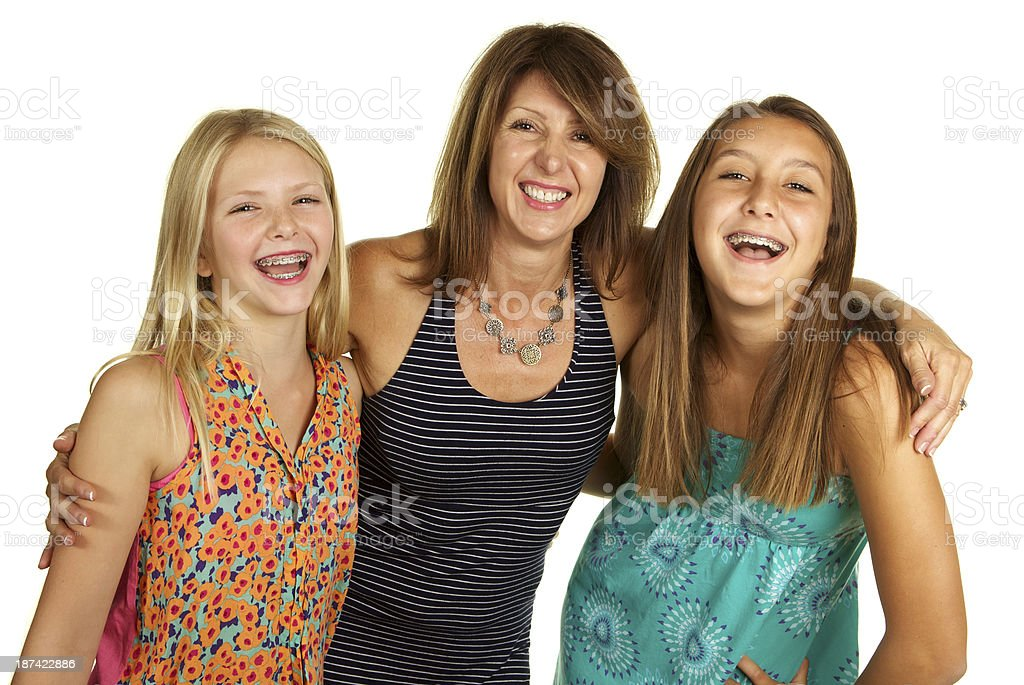 Mother and Daughters Laughing on a White Background royalty-free stock photo
