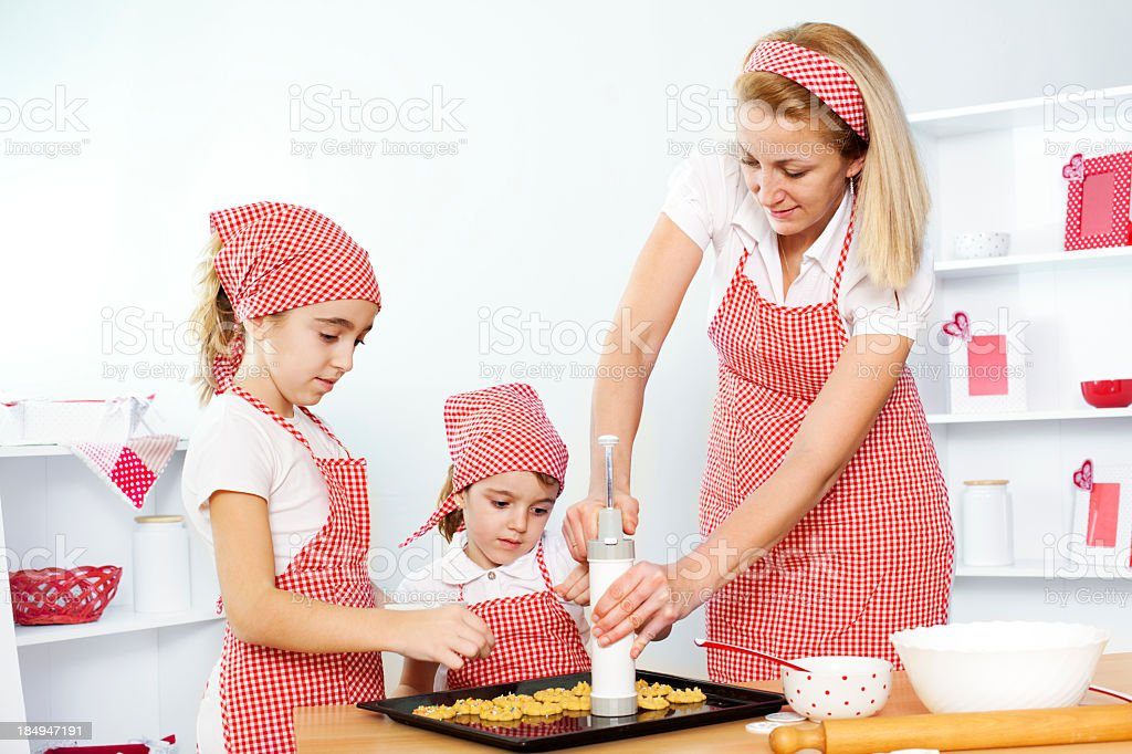 Mother and Daughters Making Cookies stock photo