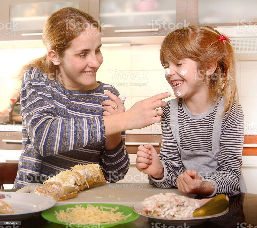 Mother and daughters making cookies royalty-free stock photo
