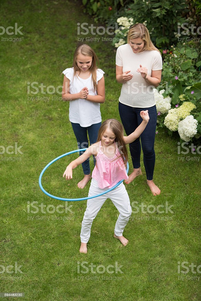 Mother and daughters playing outdoors stock photo