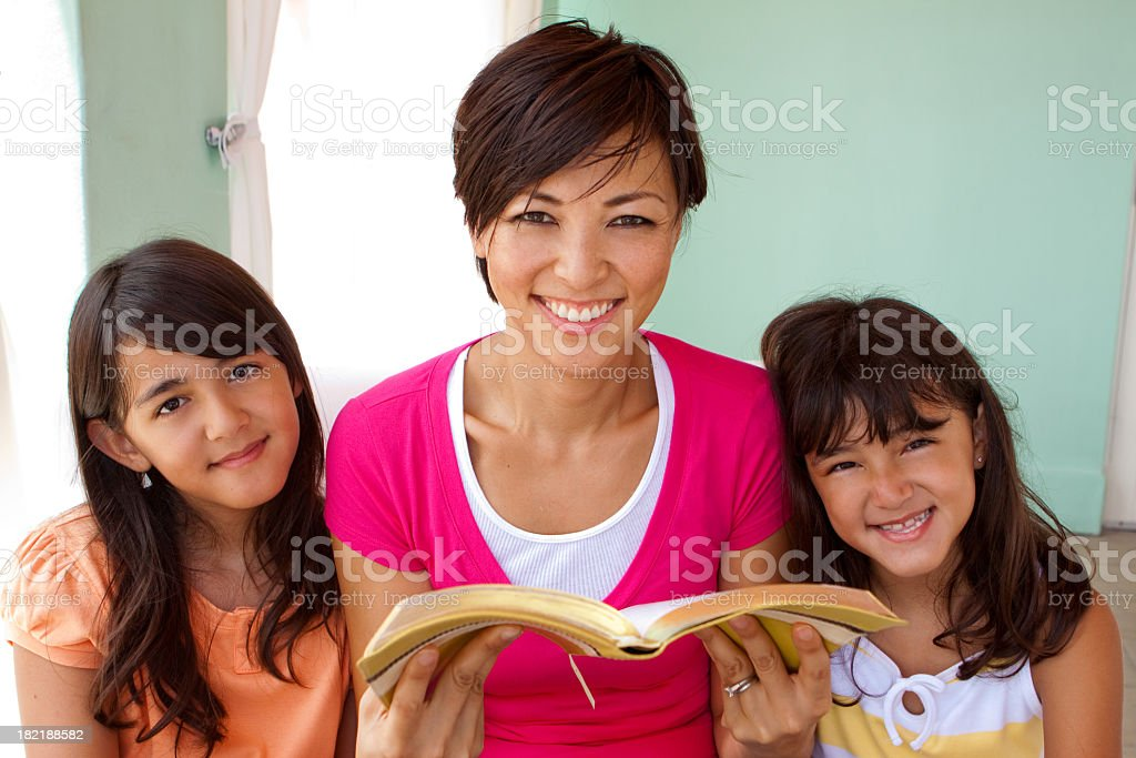 Mother and Daughters Reading royalty-free stock photo