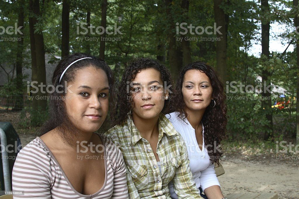 mother and daughters serious royalty-free stock photo