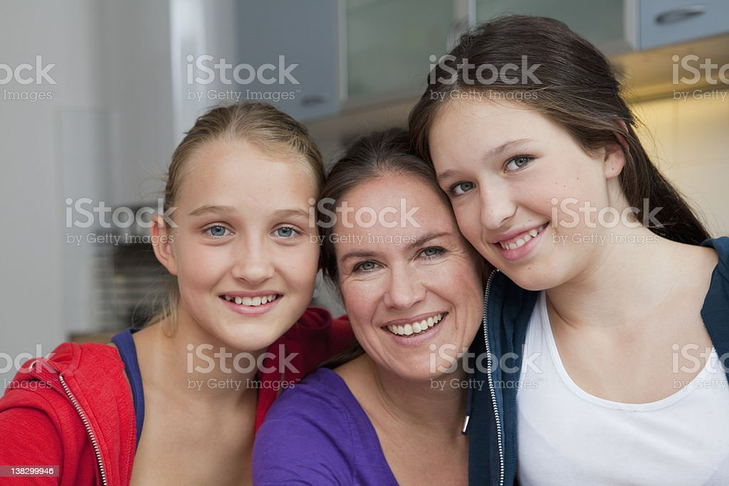 Mother and daughters smiling together stock photo
