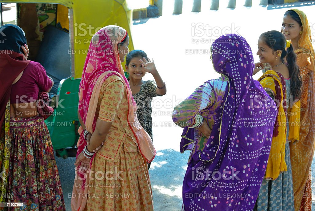 Mother and daughters waiting for a bus royalty-free stock photo