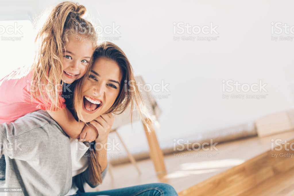 Mother and daughther happy together stock photo