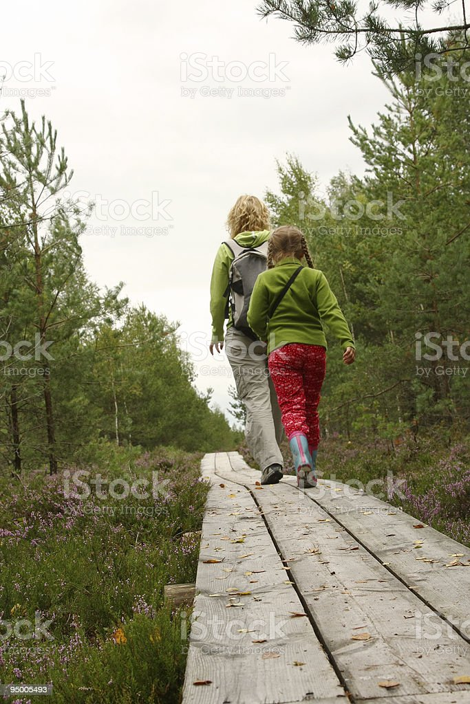 Mother and daughthter walking in forest royalty-free stock photo
