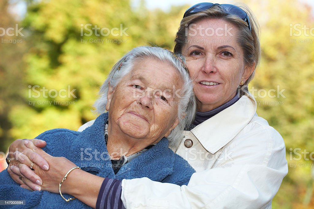 Mother and daugther cuddling stock photo