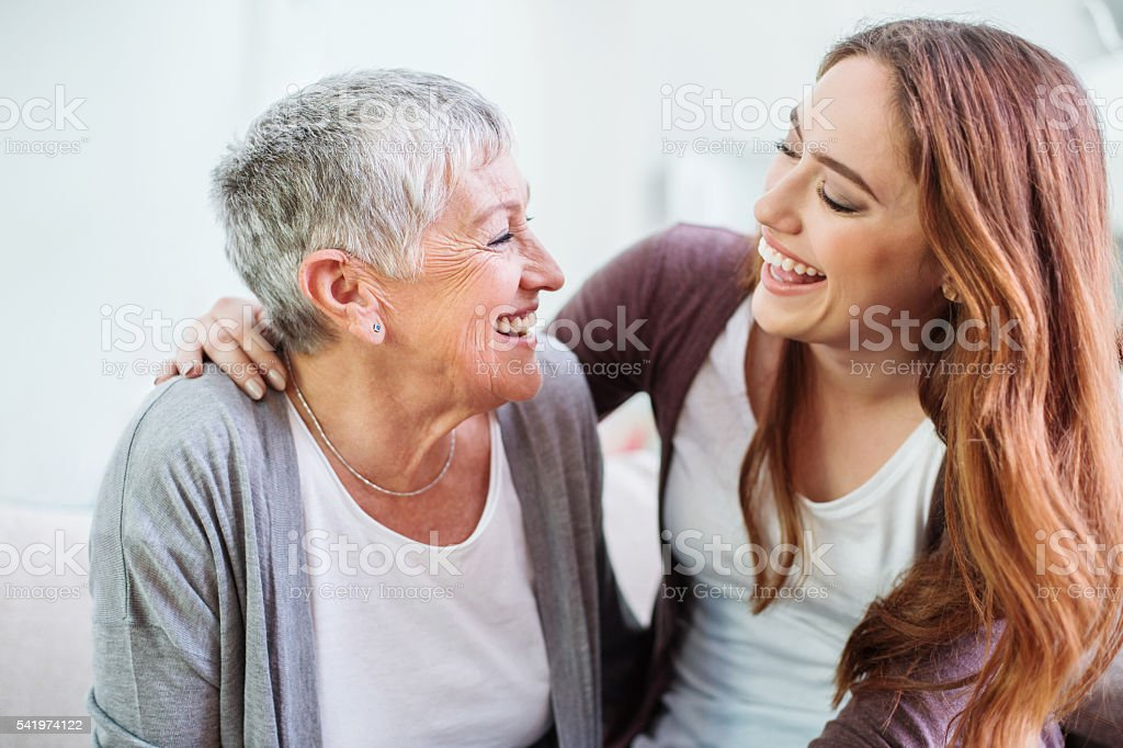 Mother and dauther laughing together stock photo