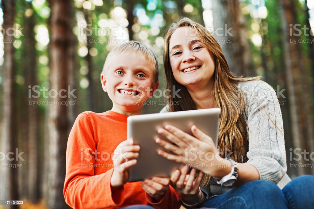 Mother and delighted son with brand-new tablet computer stock photo
