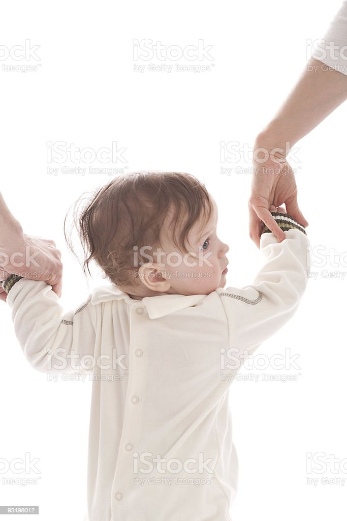 Mother and father guide his baby boy stock photo