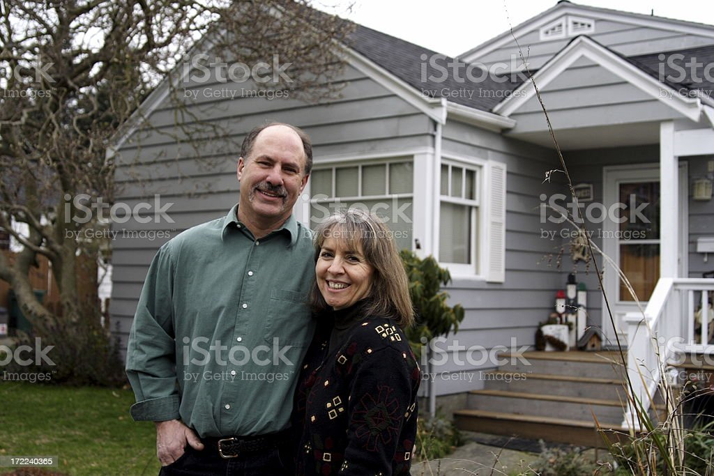 mother and father in front of home royalty-free stock photo