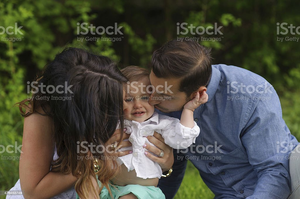 Mother and Father Kissing Son royalty-free stock photo