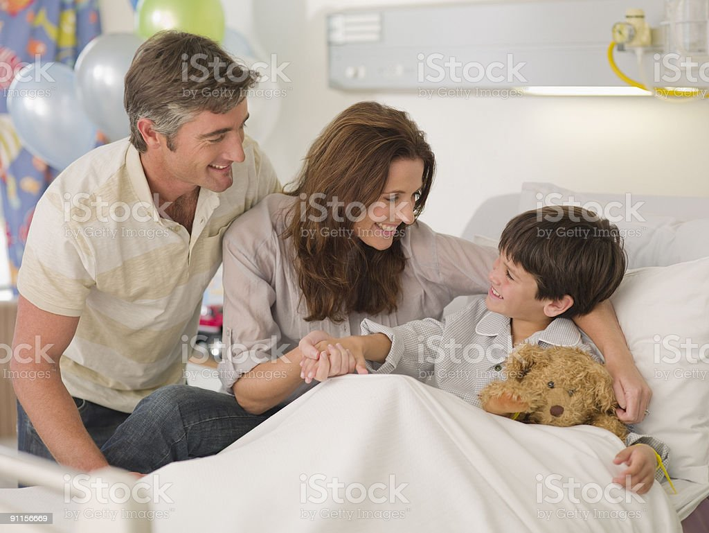 Mother and father visiting son in hospital royalty-free stock photo