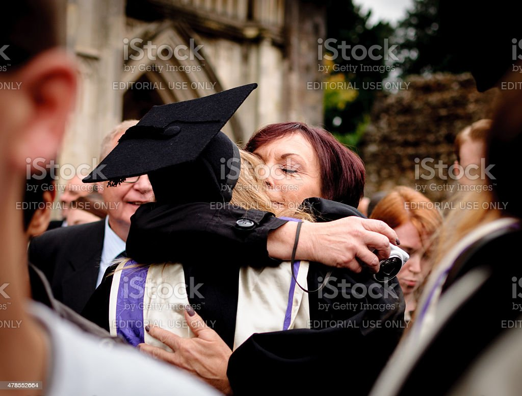 Mother and graduate daughter embrace stock photo