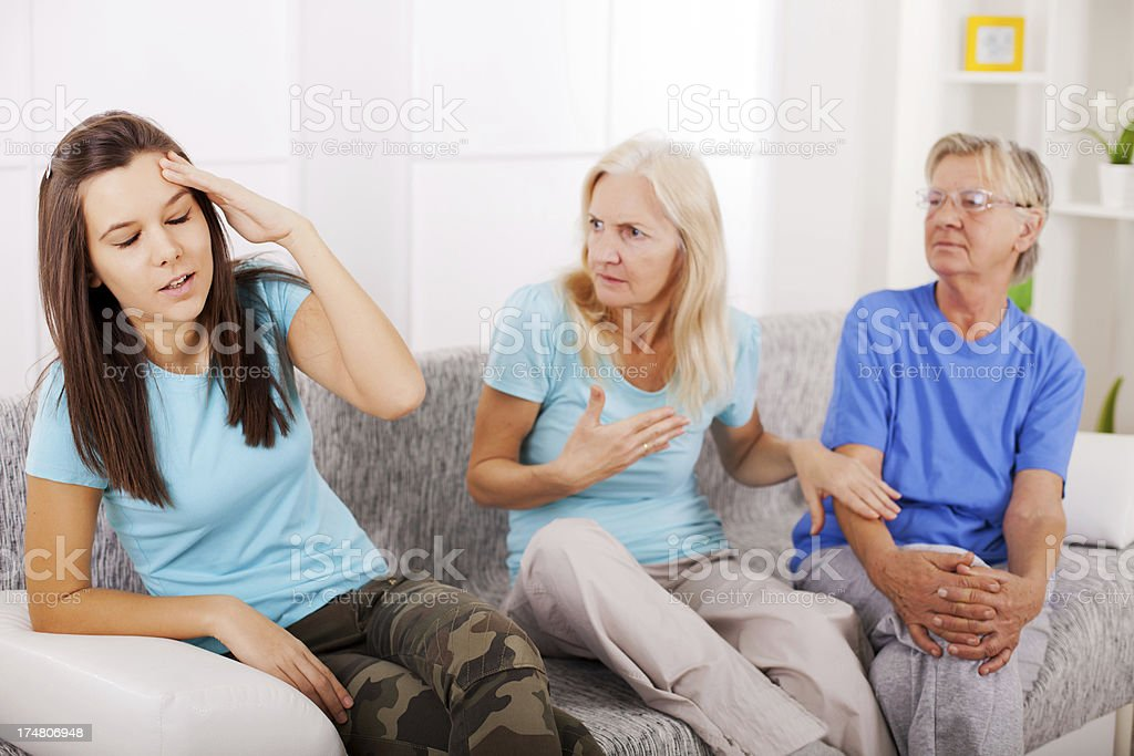 Mother and grandmother scolding young girl. royalty-free stock photo