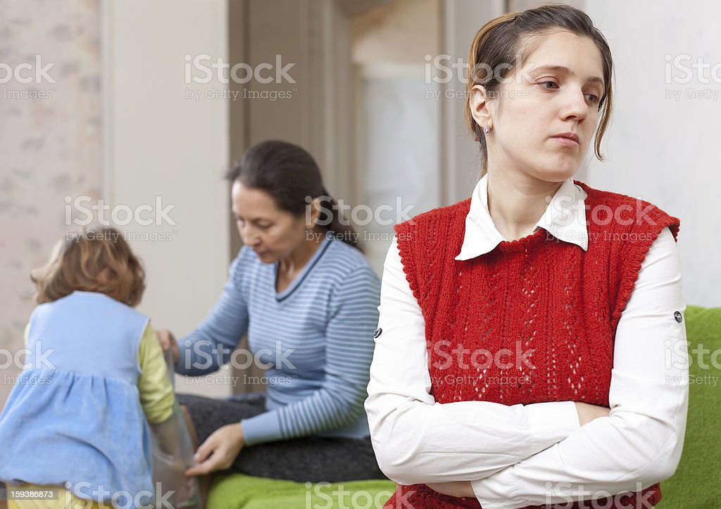 mother and  grandmother with baby after quarrel stock photo