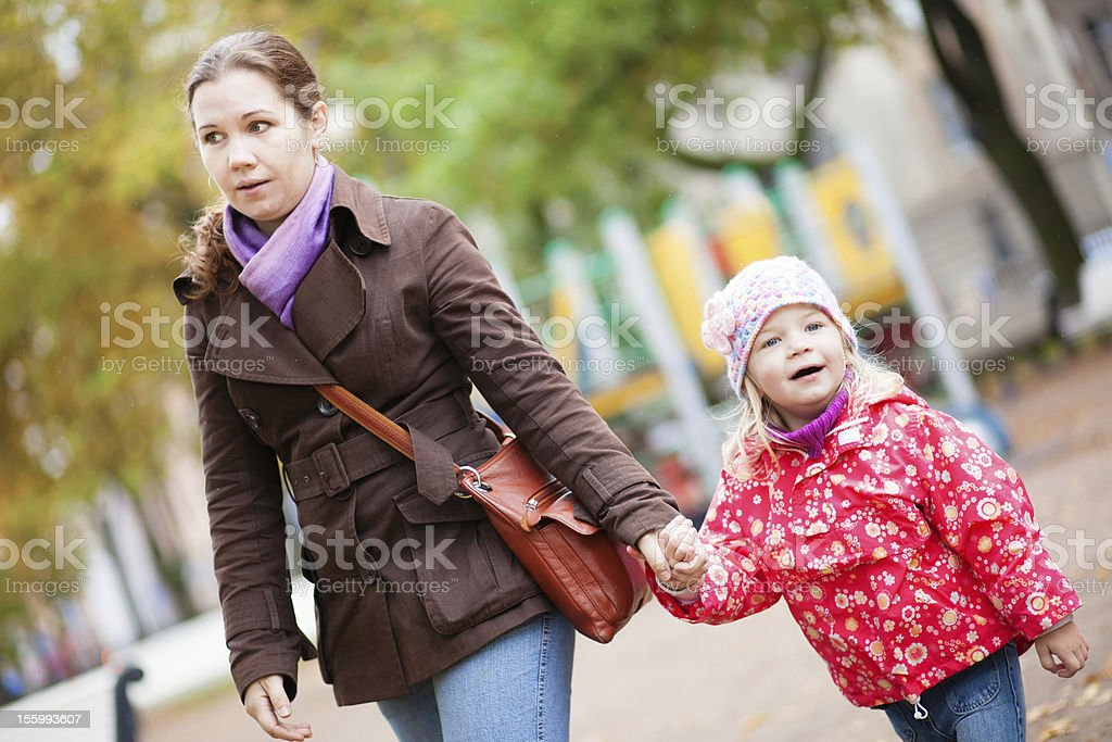 Mother and her adorable daughter walking together royalty-free stock photo
