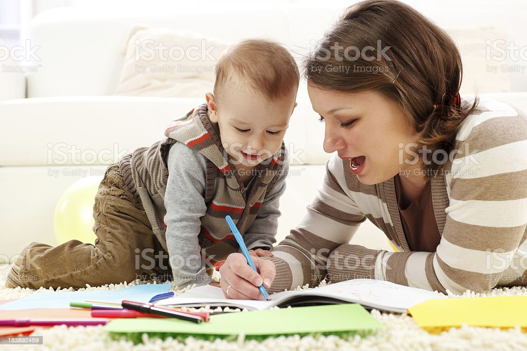 Mother and her baby boy drawing, coloring. royalty-free stock photo