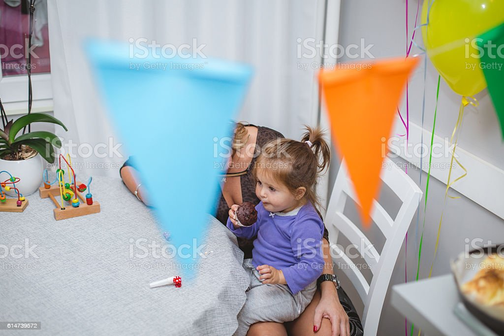 mother and her baby celebrating birthday stock photo