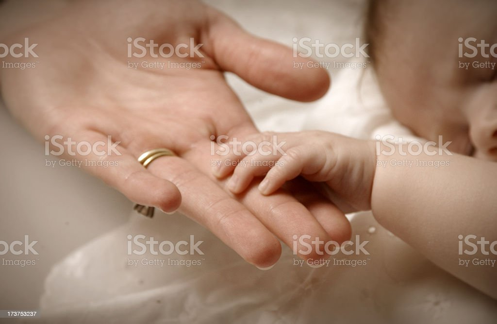 Mother and her baby holding hands stock photo