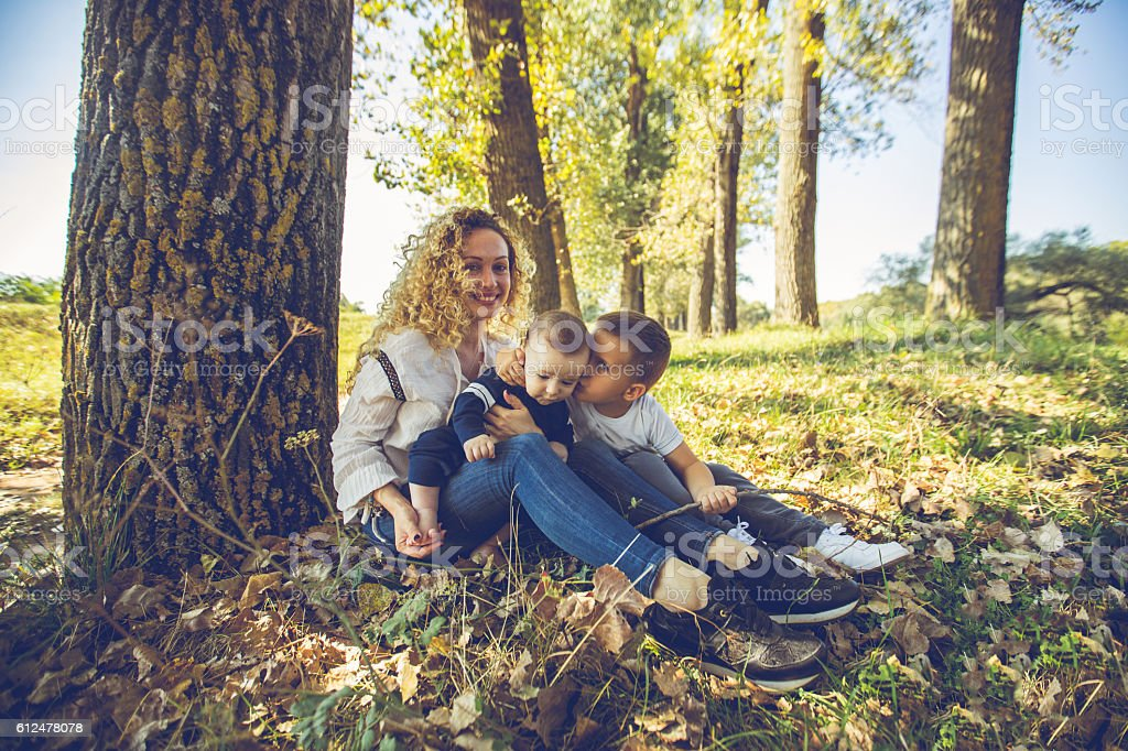 Mother and her boys stock photo