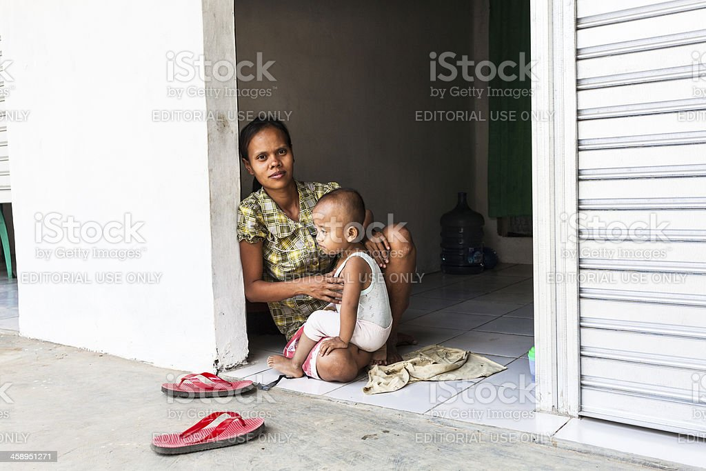 Mother and Her Child in a Rural Village of Indonesia royalty-free stock photo