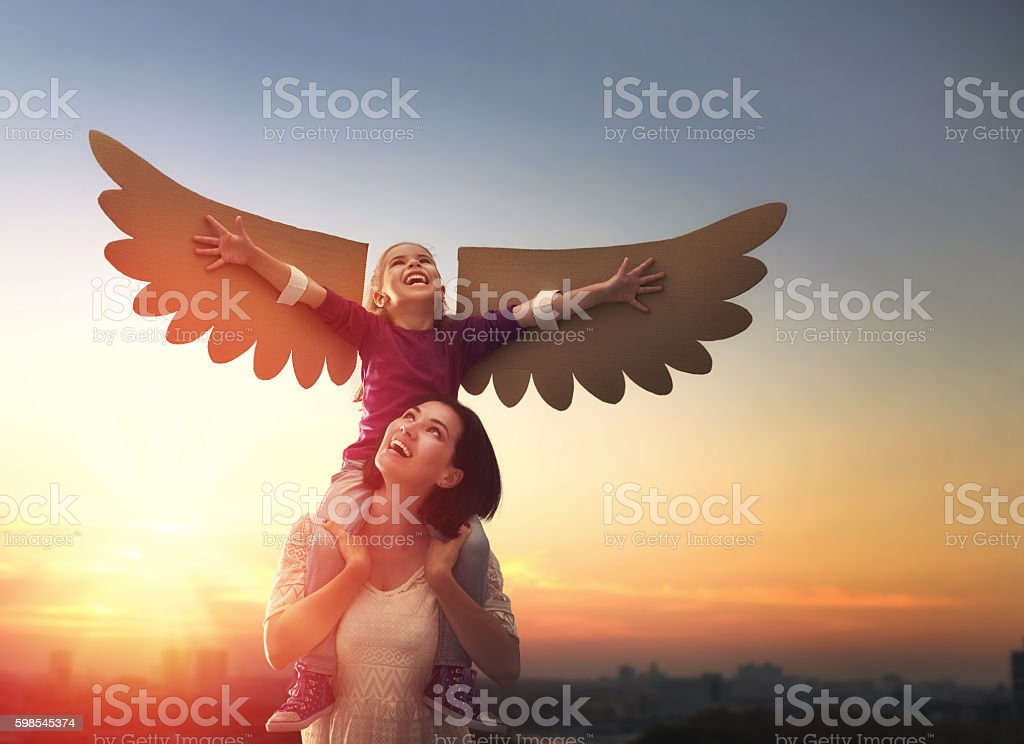 Mother and her child playing stock photo
