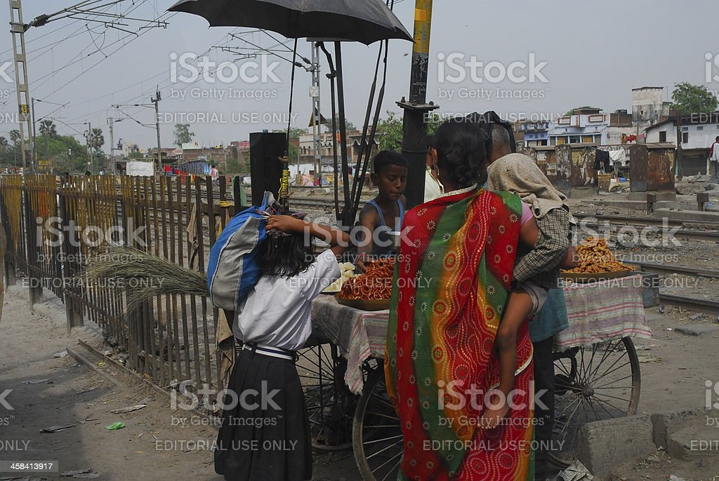 Mother and her children buying sweets royalty-free stock photo