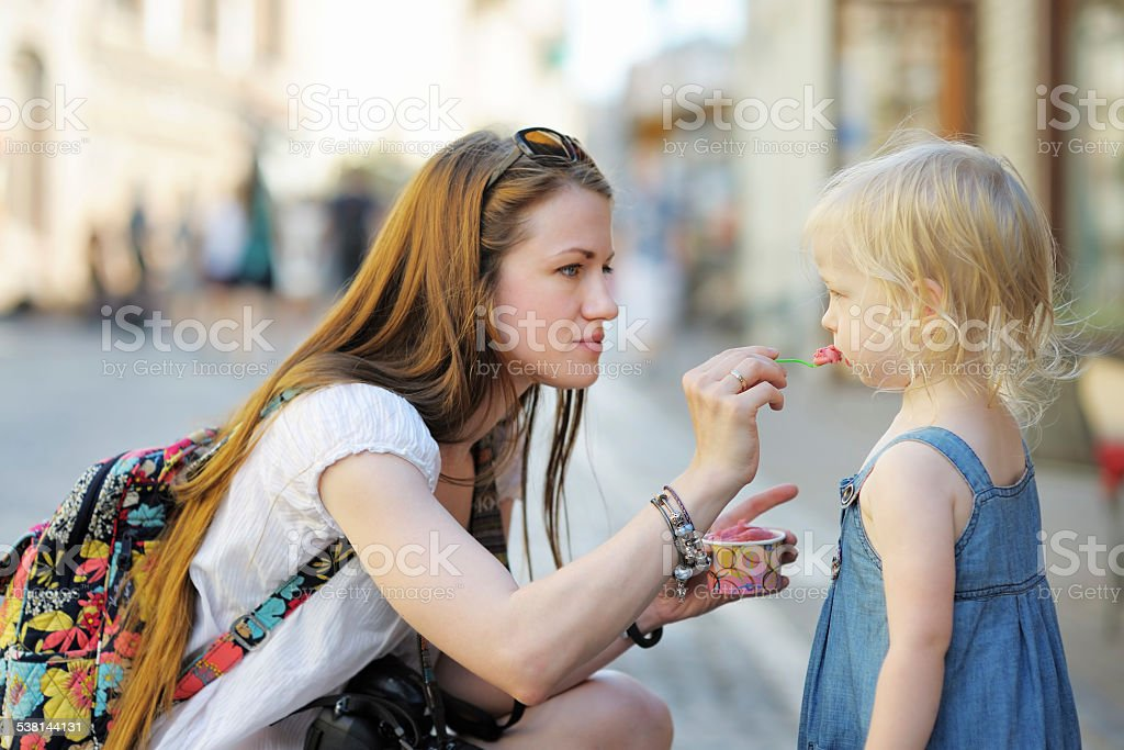 Mother and her daughter eating ice cream stock photo