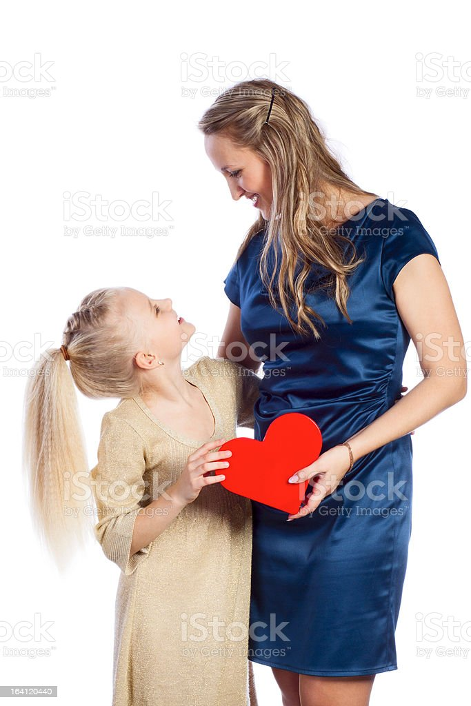 Mother and her daughter keeps heart royalty-free stock photo