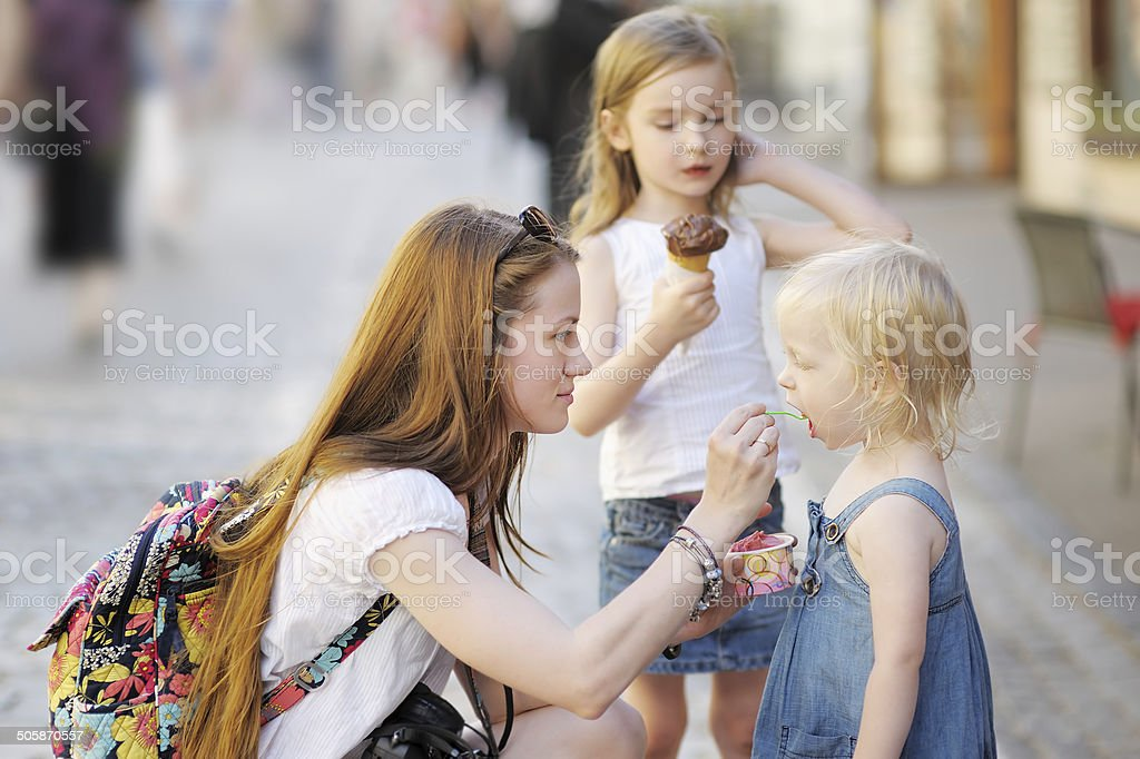 Mother and her daughters eating ice cream stock photo