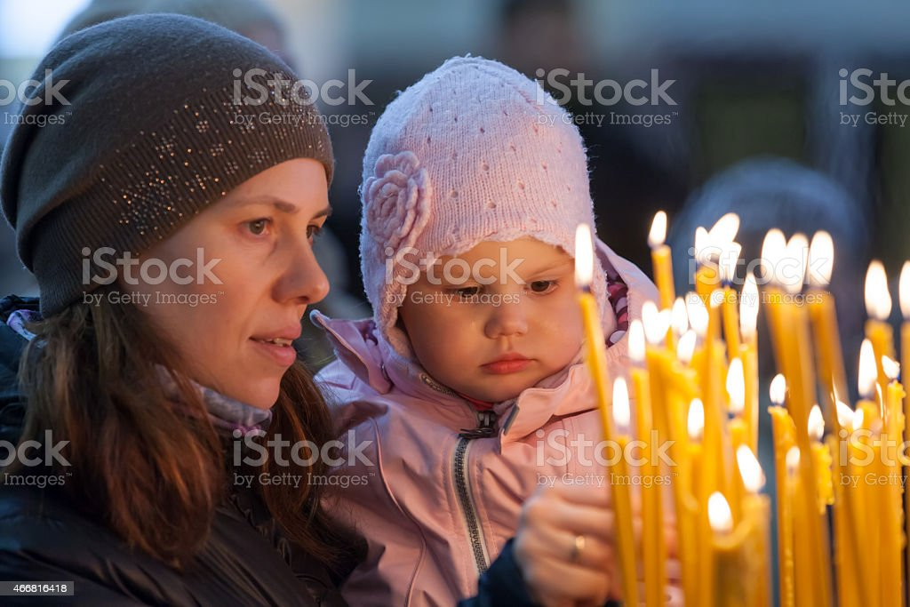 Mother and her little blond girl in Russian Church stock photo