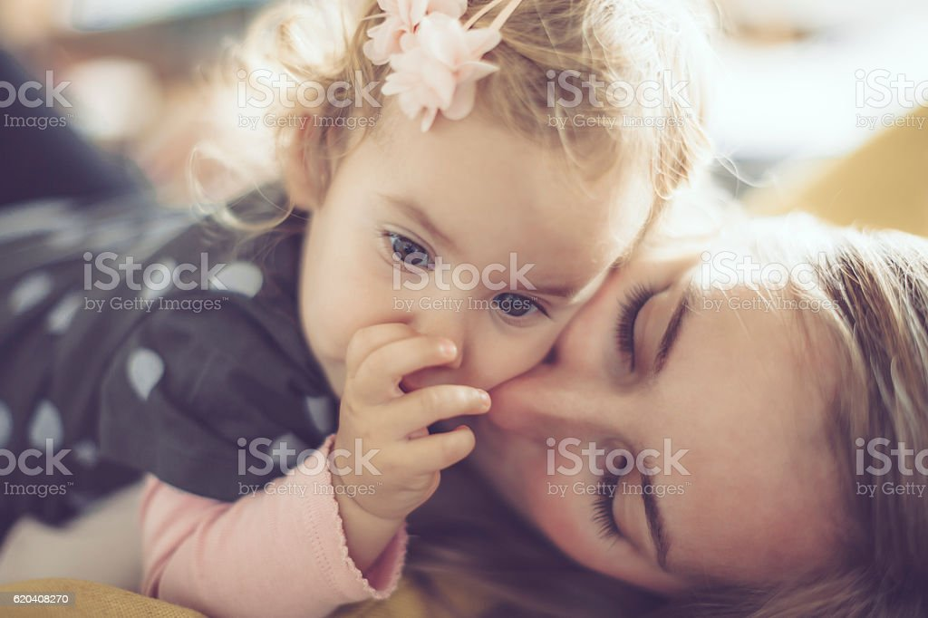 Mother and her little daughter at home stock photo
