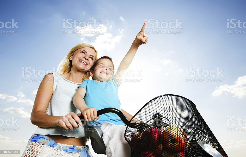 Mother and her son riding a bike. royalty-free stock photo