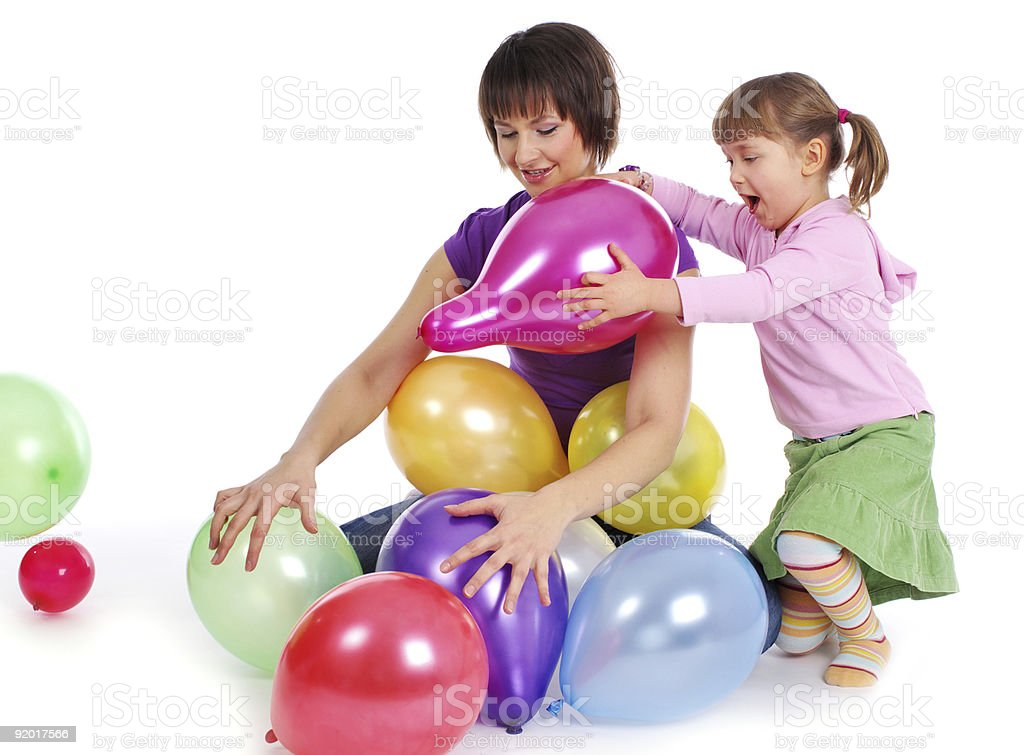 Mother and his two daughters playing  balloons. royalty-free stock photo